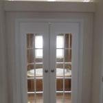 The big oak American ranch series. French doors going into the master bath suite.