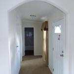 The big oak American ranch Front entryway hall with Arch.