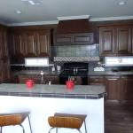 the big oak American ranch Kitchen with raised bar island