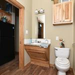 The Honeysuckle Model P-504 by Platinum Cottages and RRC Athens. This wheelchair friendly model features a roll-in shower w/ grab bars and a fold down seat. it also features wider doorways and other features making accessibility easier.