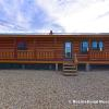 The 853 Sequoia Rustic Ranch model by Platinum Cottages & Recreational Resort Cottages Athens. Log sided cabin with wrap around porch and 2 bedrooms 2 baths.