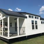 White Farmhouse Premier P577 with grey painted cabs, clerestory, and an optional island by Platinum Cottages. This custom built house was for an RRC Athens customer.